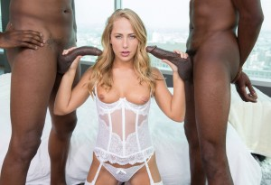 Carter Cruise jerks two black cocks